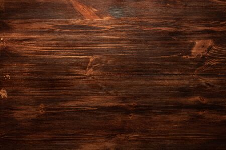 Background texture of old dark brown wood with defects. Copy space text