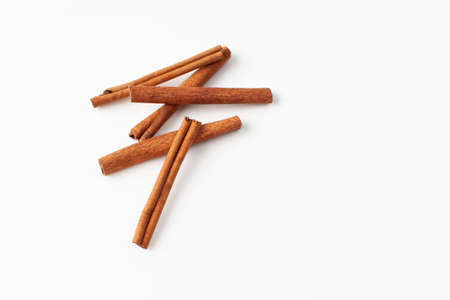 Five cinnamon sticks in the recipes of cosmetics and cooking, folk medicine. Copy space text.