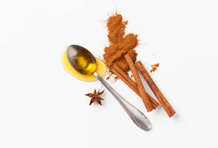Honey and cinnamon in home made cosmetics and cooking recipes on a white background. The view from the top. Copy space text.