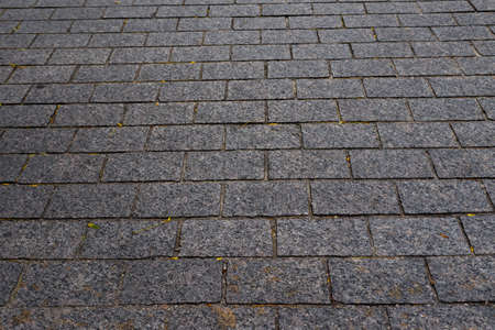 cobblestone sidewalk background. Grey stone texture photo