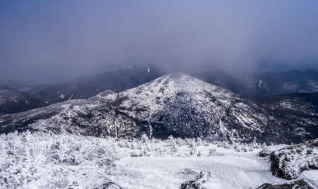 Clouds clearing over a mountain peak