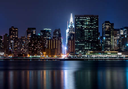 42nd: looking down 42nd street at night in New York City from across the East River Stock Photo