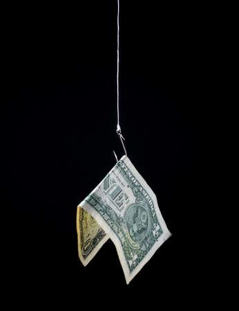 money hanging on a fish hook as bait - concept image - risk, profit, loss, investment, etc. Banque d'images