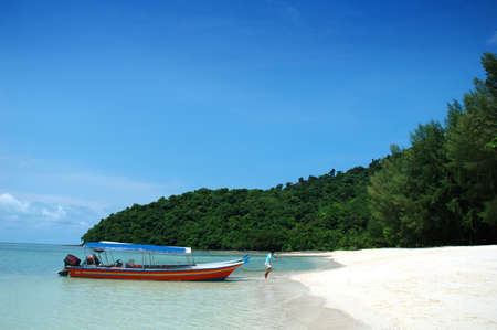 a bathing place: boat and beautiful beach