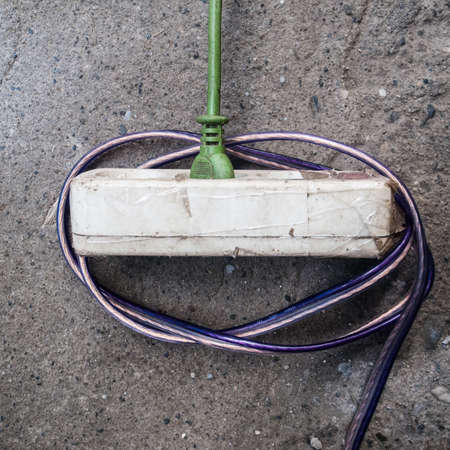 plugged in': The green cable plugged in to an electric socket.