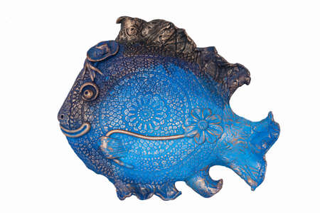 Beautiful and funny fish made of clay photo