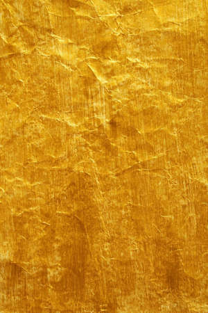 yellowish: Golden color painted crinkled paper as background Stock Photo