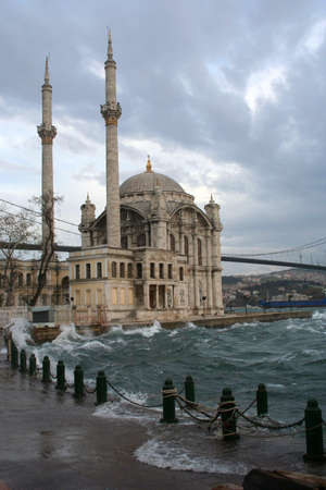 Ortakoy Mosque on a wind, rainy weather, Turkey