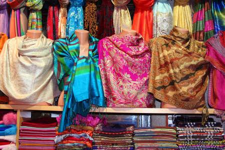 Colorful scarfs in line at market Standard-Bild