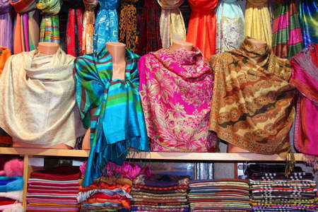 Colorful scarfs in line at market Stockfoto