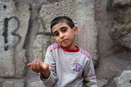 lost child: boy asking money Stock Photo