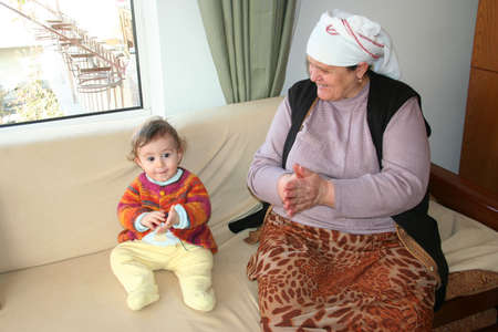 grand son and grand mother playing together