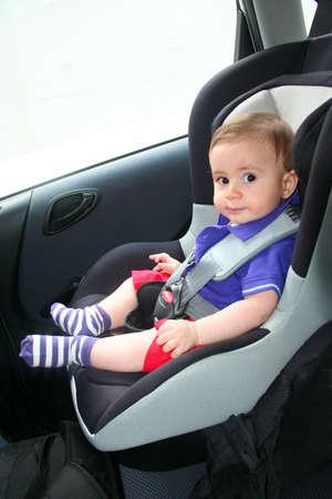 baby in car safety Foto de archivo