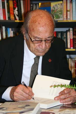 Turkish famous writer Hifzi Topuz, signing his book for his fun Editöryel