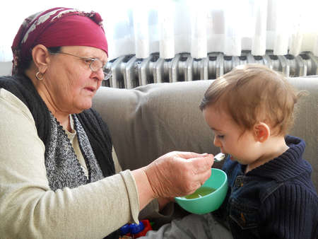 grand son: grandmom feeding her grand son