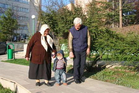 grandfather,grandmotherand garnd son at kindergaden