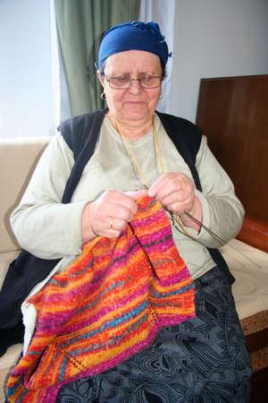 old lady knitting wool photo