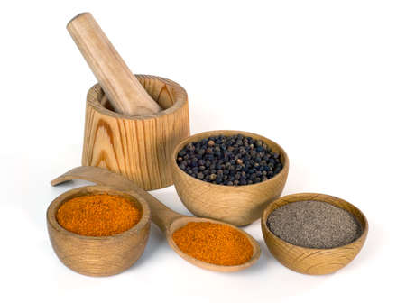 variety of spices and seasonings in wooden bowl on white background