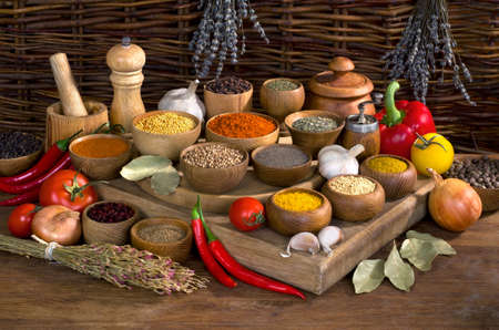 thereof: still life with spices and herbs in wooden bowl on wooden table Stock Photo