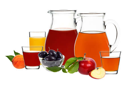 apple, plum and peach juice in glasses and decanters with berries and fruit on a white background photo