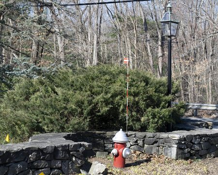 Fire hydrant with lamp and stone wall