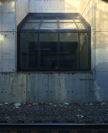 Glass enclosure at commuter rail station Stock Photo
