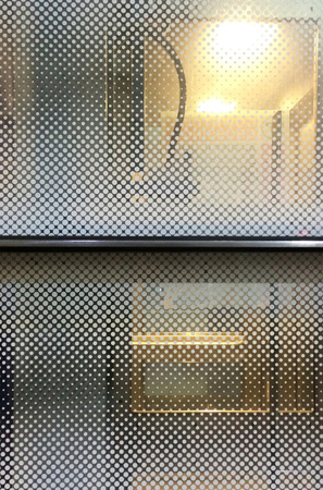 Window with dot pattern in subway station Stock Photo