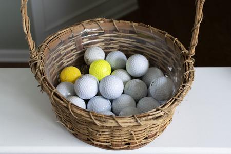 Golf balls inside wicker basket