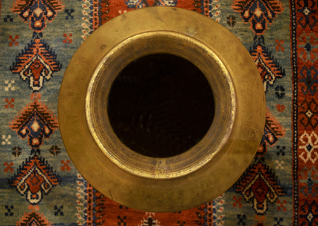 Urn from above on rug Stock Photo