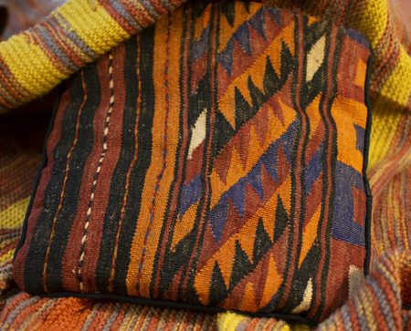 Pillow and blanket with warm colors Stock Photo