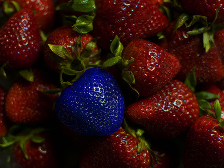 Strawberries with one blueberry