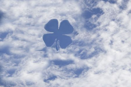 Clover shape made of cloud on sky photo