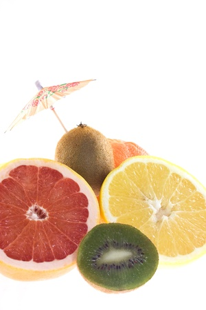 Mix of grapefruit and kiwi decorated with umbrella Stock Photo
