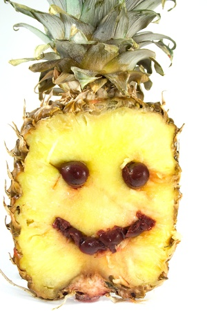 Smiling pineapple with cherry