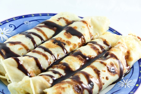 Pancakes with chocolate on plate