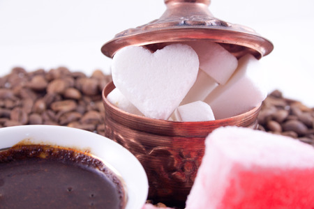 Heart shaped sugar with coffee and sweet