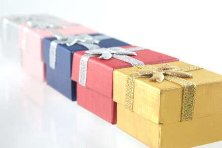 Row of little giftboxes Stock Photo