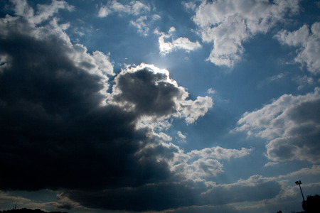 Sun behind clouds in summer Stock Photo