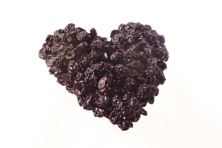 Heart made of dried cherry Stock Photo