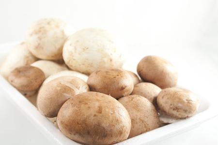 Fresh mushrooms in box Stock Photo