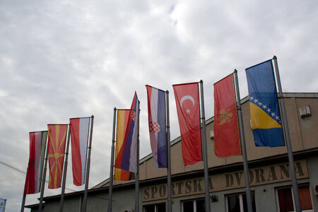 LUKAVAC, BOSNIA AND HERZEGOVINA - MAY 8, 2014  Flags in front of touristic fair
