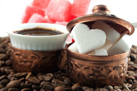 Coffee with heart shaped sugar and locum
