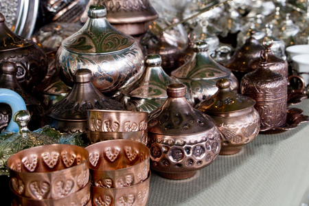 Copper souvenirs at traditional fair Stock Photo
