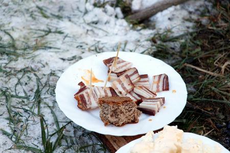 Sliced bacon on plate outside