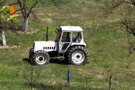 White tractor on field Stock Photo