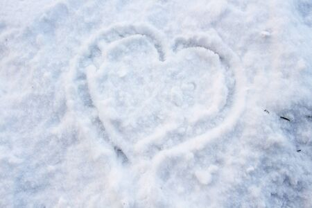 Heart shape in snow Stock Photo
