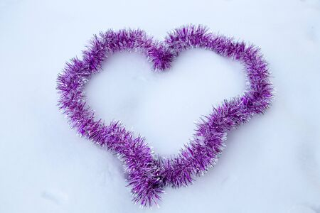 Heart made of decoration tape on snow