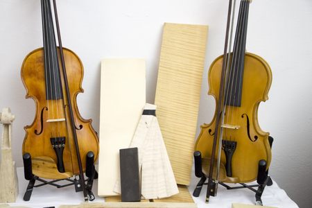 Violins on the table during fair Stock Photo