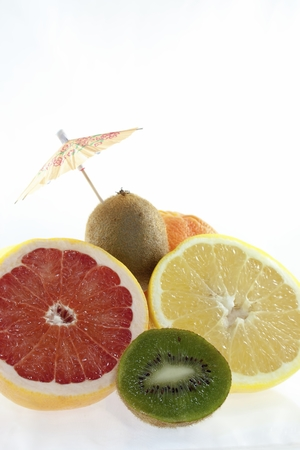 Studio shot of fruits with umbrella decoration Stock Photo
