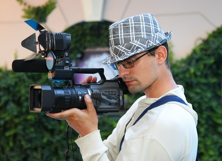 A young man with a video camera Stock Photo